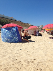 Most of the umbrellas further were adorned with fabric to the sand, allowing for shade and anonymity I suppose.